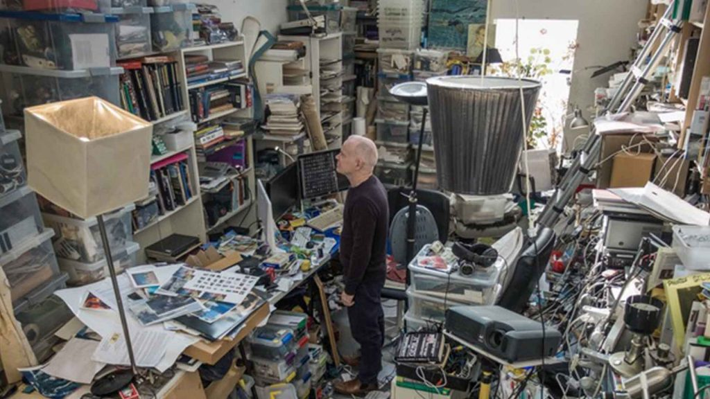 Tomorrow-Is-Saturday-5-Sean-Hillen-in-cluttered-studio-space-before-de-clutter-by-gmarsh-television
