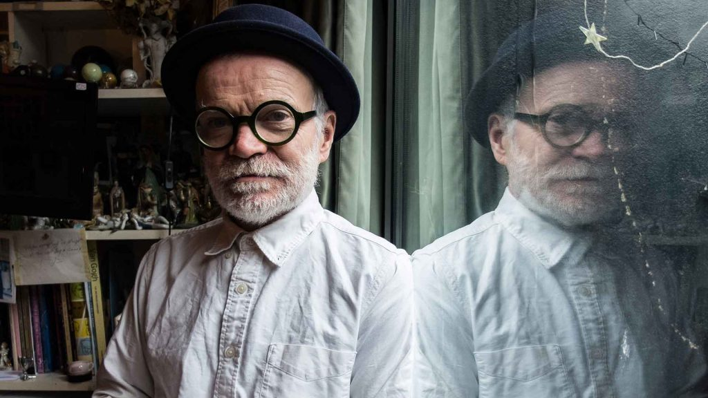 Tomorrow-Is-Saturday-6-Sean-Hillenman-portrait-photo-man-with-white-beard-and-round-glasses-and-black-hat